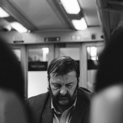 Man on the train, black and white film image,  Fujica ST605 vintage camera, 2019