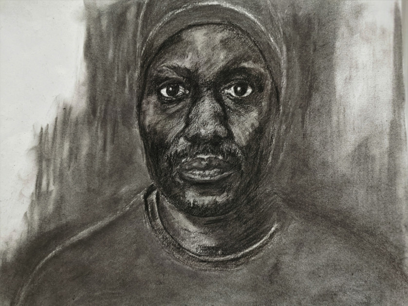 Man with hat, black charcoal on paper, 30 x 43 cm, 2015