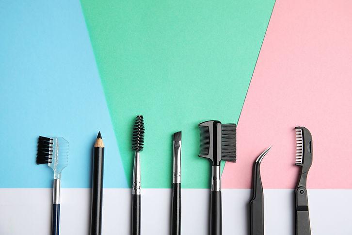 Set of professional eyebrow tools on col
