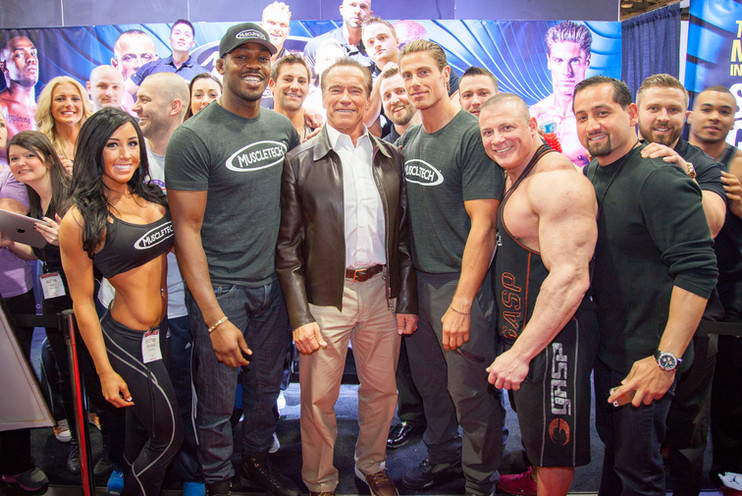 Group photo with Arnold Schwarzennegger, UFC star Jon Jones, former NFL defensive end Marc Megna, and the rest of the MuscleTech crew at the Arnold Classic expo.