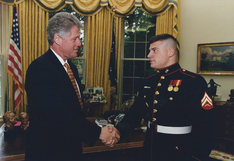 Shaking hands with President Bill Clinton in the White House's Oval Office.