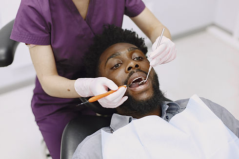 young-african-american-man-guy-visiting-dentist-s-office-prevention-oral-cavity-man-famale...eth.jpg
