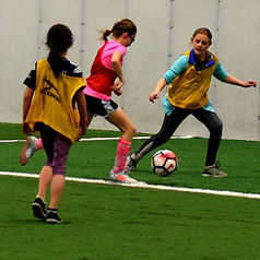 Players participating in skill-building drills during Soccer Skills Clinics.