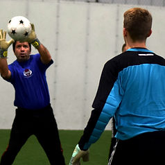 Coach Pardo teaching bal handling technique during Goalkeeper Training Clinics.