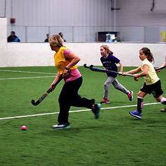 Practicing ball control and defense during Field Hockey Skills Clinics.