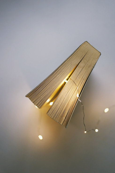 closed-book-beside-gray-string-light-on-
