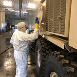 Coating specialist spraying carwell application