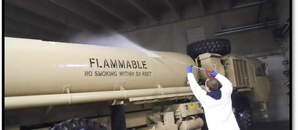 Washing a Military fuel tank truck