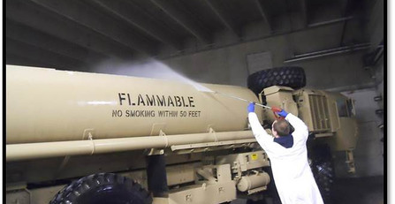 Power washing a military fuel tank truck