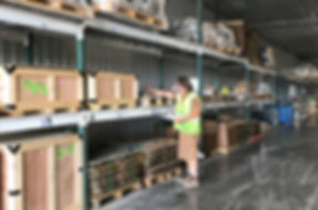 Material hadler checking labels in QPC's warehouse