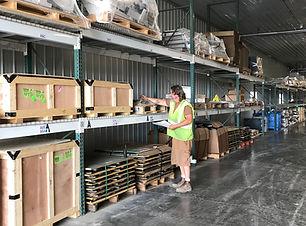 Material handler checkin labels inside QPC's warehouse