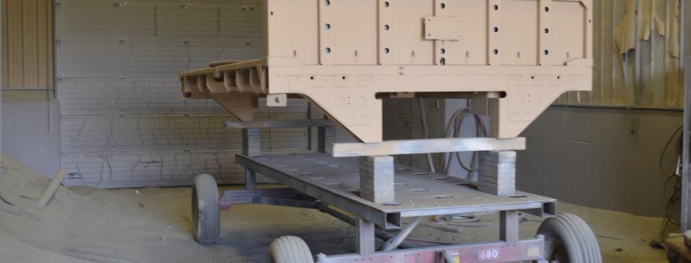 Military trailer in blast bay