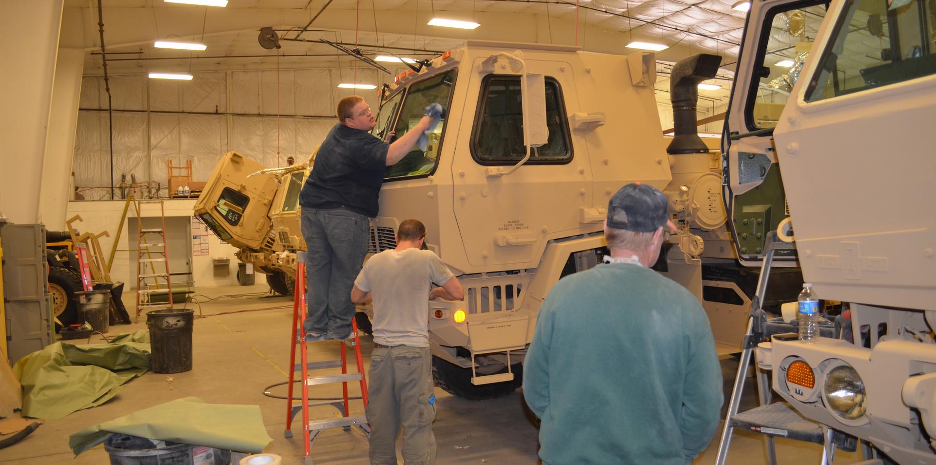 Working on FMTV military trucks