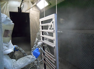 Coating specialist spraying a component on the paintline