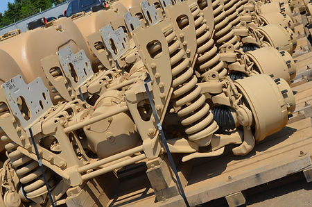 Military axles in the shop yard after being paited CARC tan