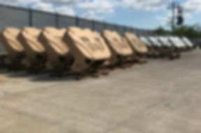 Military JLTV hoods stored in the QPC shop yard after being painted CARC tan