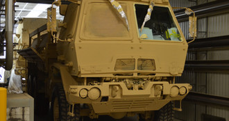 Half-masked FMTV military truck