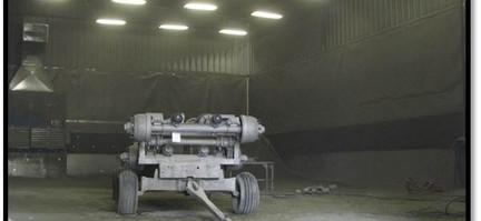 Military axles in QPC's Large media blast bay