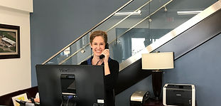Receptionist smiling answering the phone