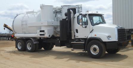White and Black mud dog truck