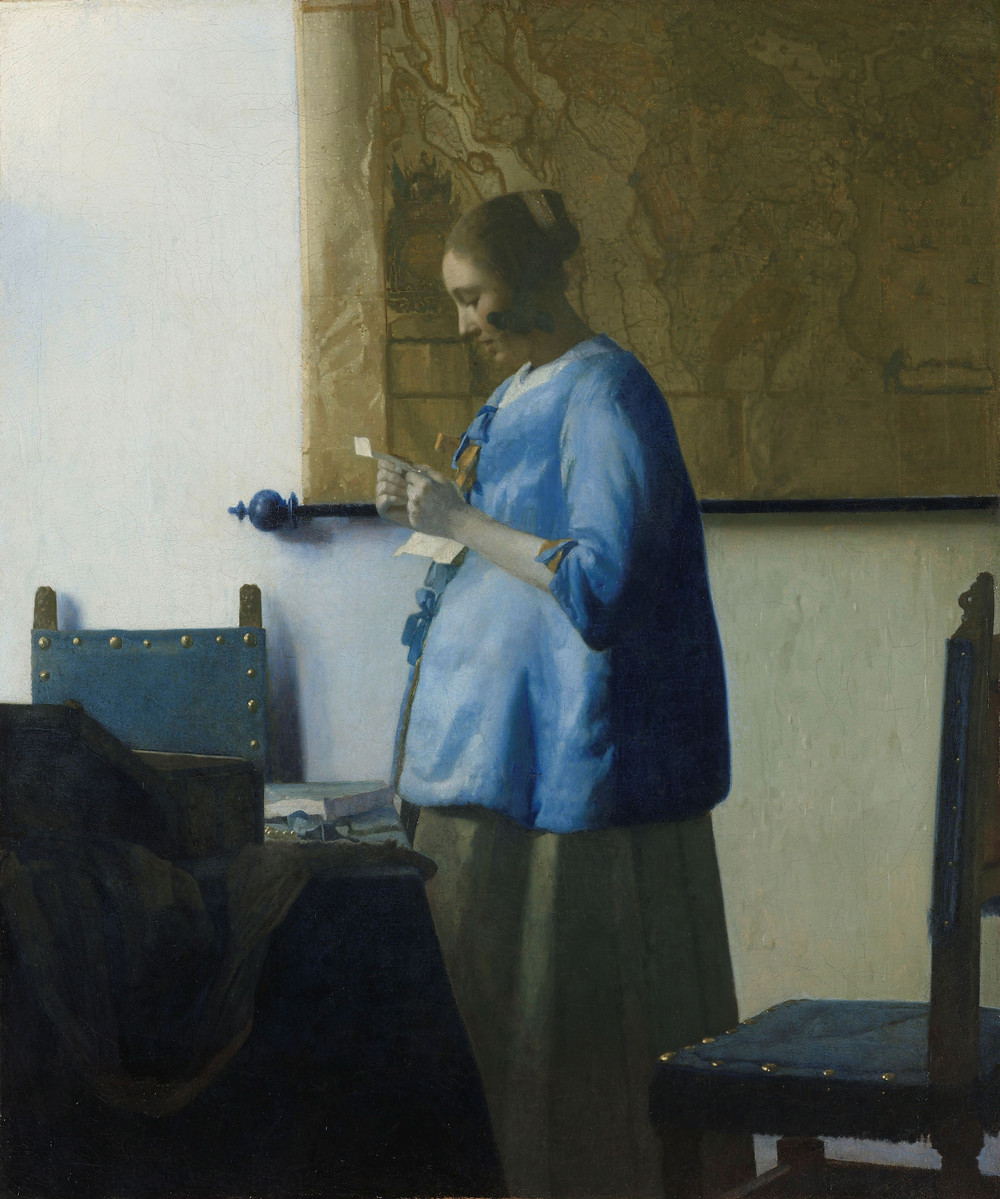 Vermeer painting of woman reading letter