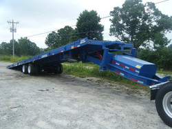 Pintle hook container delivery trailer with sliding axles and tilt deck