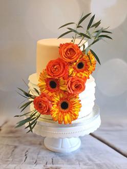 Bruidstaart oranje bloemen