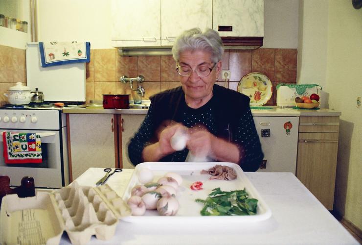 Milena prepares some Easter eggs