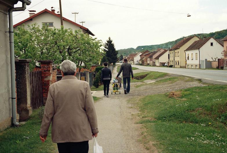Milena walks to the graveyard