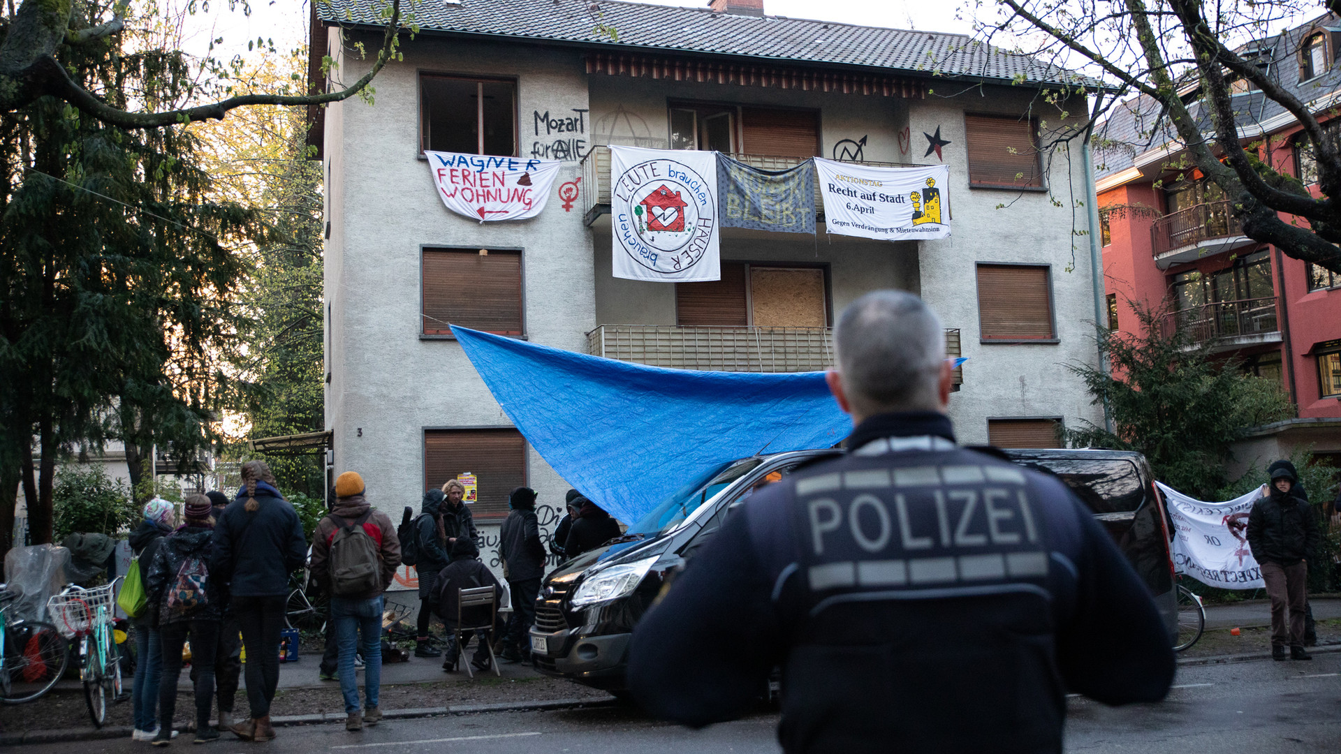 Police arrive at a house squat