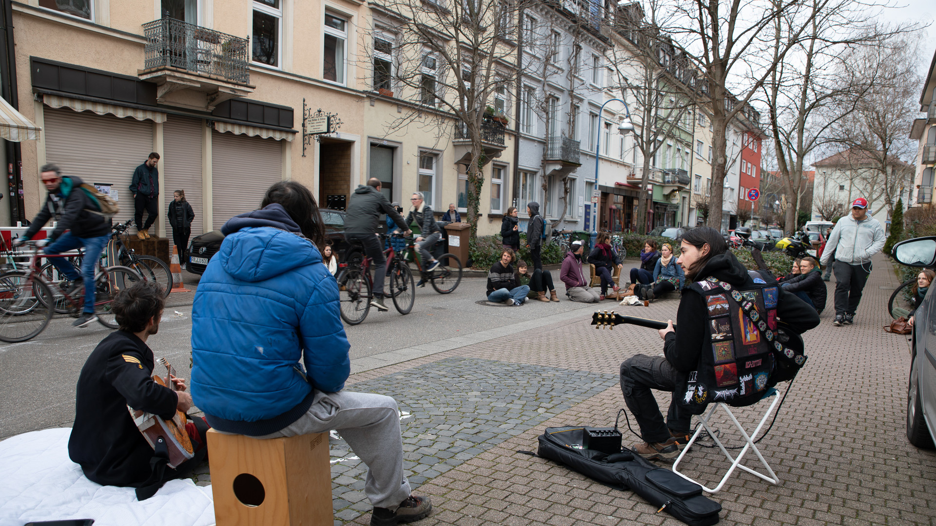 Members and friends of Die WG play music during a house squat