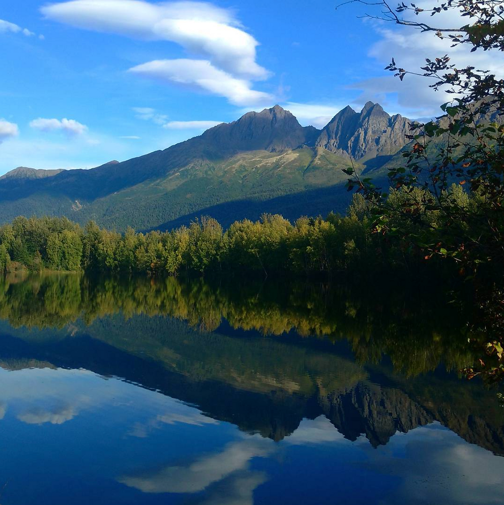 mountains reflected in mirror lake