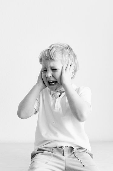 grayscale-photo-of-a-boy-crying-3905731.