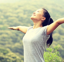 young-asian-woman-breathing-fresh-air-in