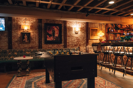 South House Bar and Restaurant bar area with brick walls, exposed beams, Foosball table and banquets