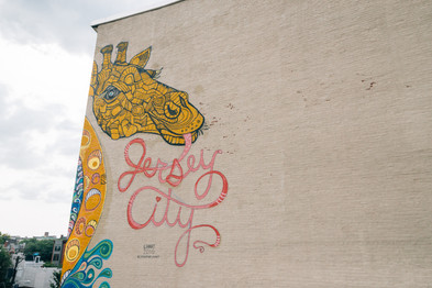 Giraffe mural on Jersey City building by artist Catherine Hart