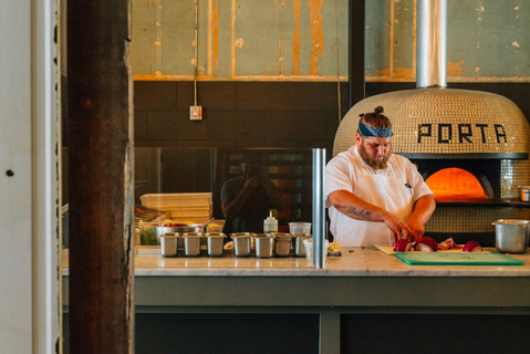 Chef at work in Porta pizza restaurant