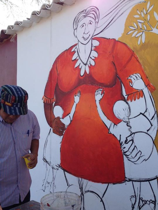 Day 3 Piura Peru the artists drew images that they designed, the kids drawings were installed and we