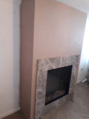 Newly plastered firebreast