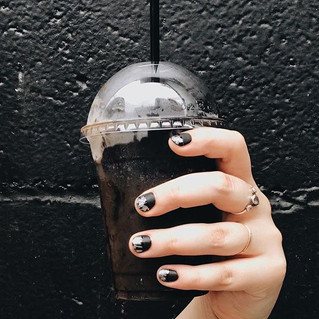 Seriously creepy coffee: A café in NYC is selling a matte black latte topped with black WHIPPED CREA