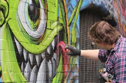 Street artist in famous Hosier Lane