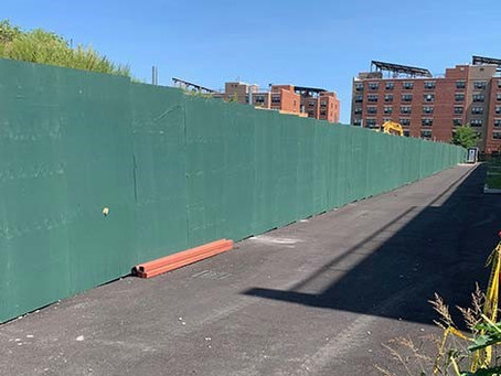 New Law Replaces Green Wooden Fences with Chain Link Fences at Stalled Construction Sites