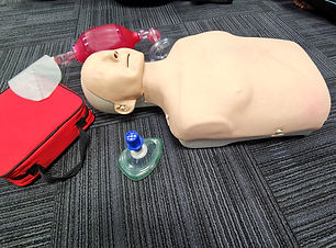 Mannequin with CPR training kits includi