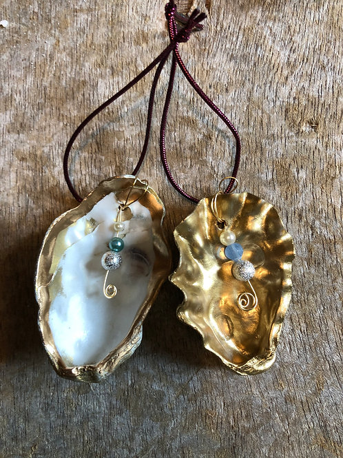 Pair of gold and gold rimmed oyster shells