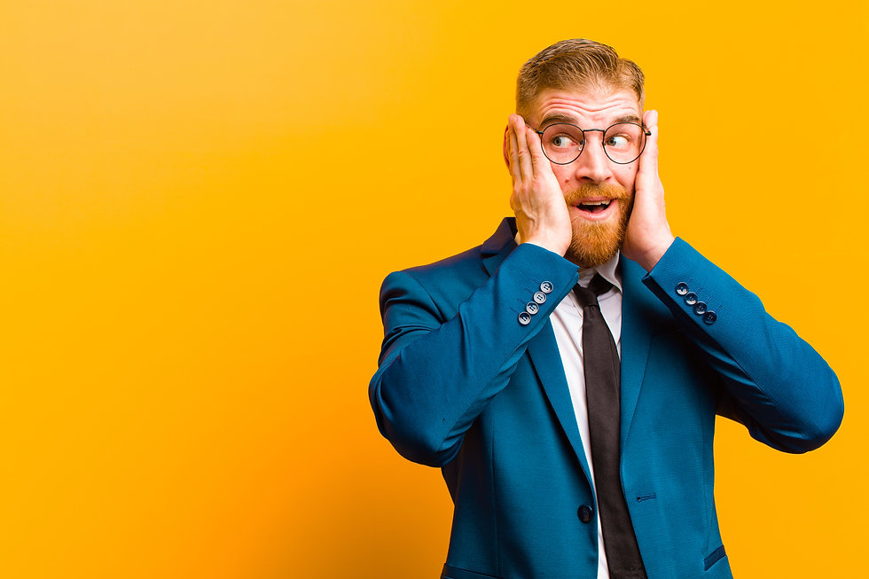 young red head businessman feeling happy