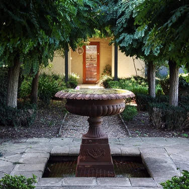 The fountain leading down to the pool pavilion