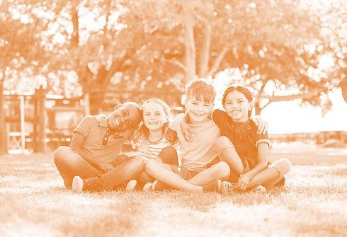 kids_sitting_orangesm.jpg