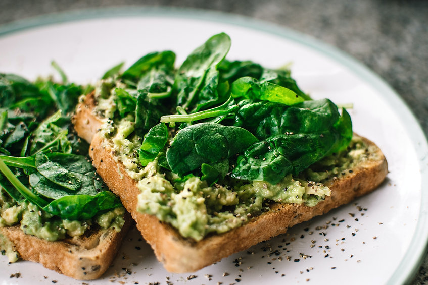 basil-leaves-and-avocado-on-sliced-bread