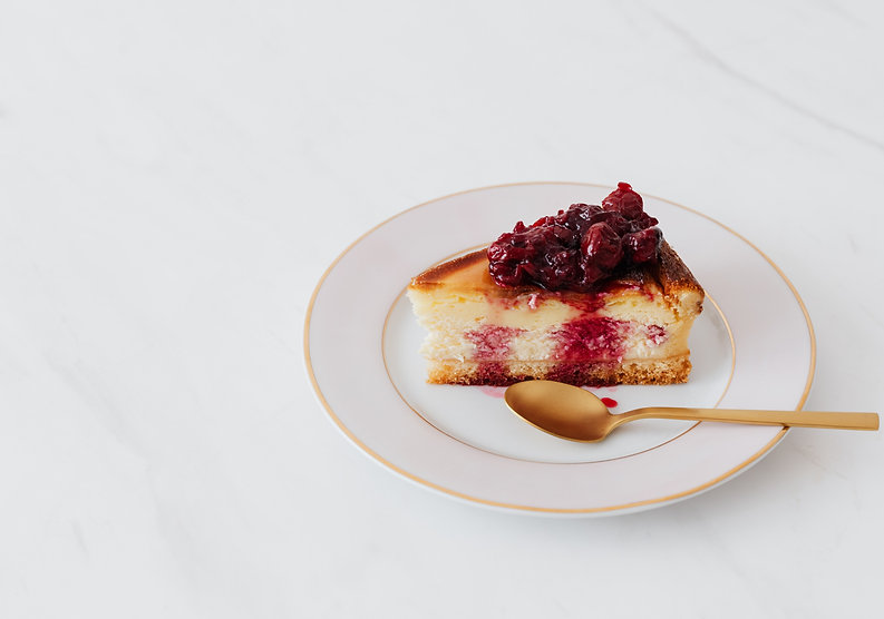 piece-of-cheesecake-on-plate-served-with