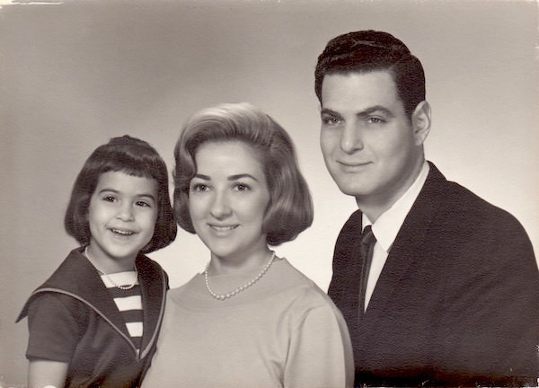 Young Julie Anne Rhodes with her parents